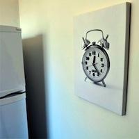 Uzzīmētais īstais pulkstenis